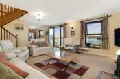 Lounge at Badger cottage with panoramic estuary views from all windows.