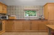 Solid oak kitchen in coastal holiday cottage in New Quay, Cardigan Bay, Wales.