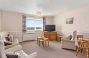 Open plan lounge / dining room in holiday apartment on Haverfordwest Golf Club in Pembrokeshire, Wales.