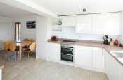 Holiday cottage on the Llyn Peninsula - Modern kitchen with a NEF halogen hob, oven, a Franke sink unit and microwave.