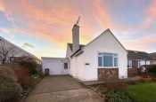 Exterior of pet friendly holiday cottage bungalow in Morfa Nefyn, on the Llyn Peninsula. Sleeps eight.