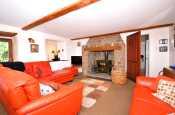 Welsh coastal cottage - sitting room with log burner