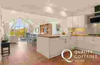 Open plan kitchen, dining room, living area with double doors to garden