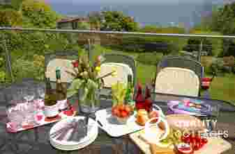New Quay holiday home - deck with views of cardigan Bay
