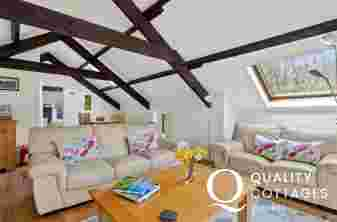 ounge/Dining area with beamed ceiling, 3 seaters and 2 seater sofas