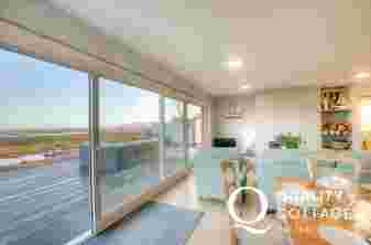 Coastal holiday cottage with sea views over Red Wharf Bay, Anglesey - the open plan lounge and patio.