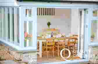 Garden room with dining table leading to garden