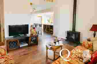 Lounge area sofa t.v and log burner