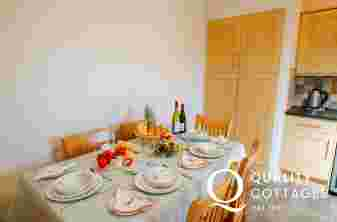 Kitchen/Dining area seating for six, table laid with fresh fruit and flowers