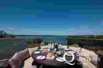 Large holiday cottage in Anglesey - balcony with seating and sea views.