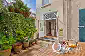 Enchanting sunny courtyard, olive grove, table & chairs, feature sheep, mature border