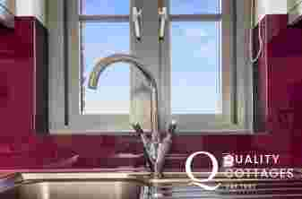 Kitchen sink taps with sea view of Pembrokeshire coast