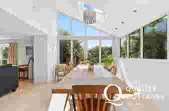 Luxury holiday cottage - dining area overlooking the gardens