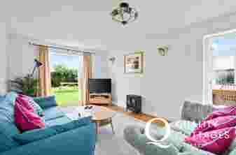 Tenby seaside town cottage holiday - lounge two settees T.V. electric log fire