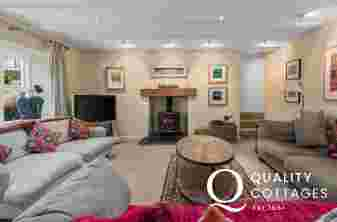 Holiday house on the St Davids Peninsula, Wales - Lounge with three sofas, log burning stove, flat screen TV and games.