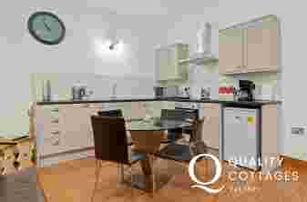 Open-plan kitchen-dining area at Owls Retreat, spacious and light.