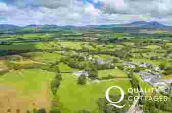 Aerial view of the area surrounding Seaborne holiday cottage in North Wales, with views over Cardigan Bay.