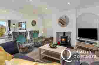 Stylish lounge with log burner, TV, Sofas - dog friendly holiday cottage near Narberth, Pembrokeshire.