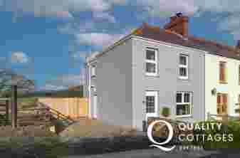 Pet friendly holiday cottage near Narberth, Pembrokeshire - exterior view with driveway parking for two cars.