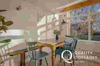 Dining room in Whitewell holiday cottage in Bosherton, Pembrokeshire with seating for six.
