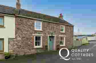 Exterior of dog friendly holiday cottage in Solva, Pembrokeshire, with enclosed garden and parking. Sleeps five.