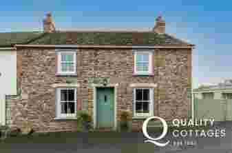 Exterior of coastal holiday cottage in Solva, Pembrokeshire. Dog friendly.