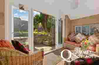 Patio doors leading to the garden of a holiday cottage in Pembrokeshire