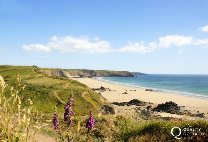 Spectacular coastal scenery over Marloes Sands from the Pembrokeshire Coast Path  - a magnificent beach with a crescent of golden sand at low tide