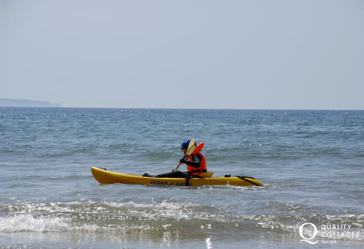 Sea kayaking at Newgale Sands. The Newsurf Shop (open 7 days a week) offers lessons and a full activity hire service