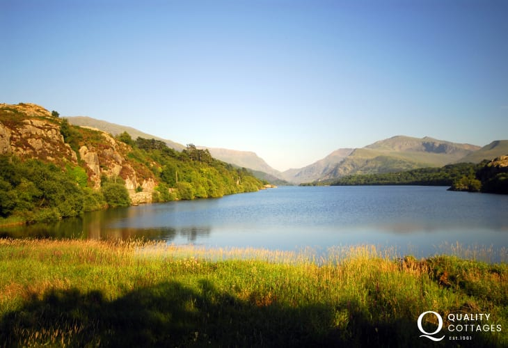 Serene Llyn Padarn (lake) at Llanberis - hire a rowing boat, ride on the lake railway or climb Mount Snowdon - the choices are endless!