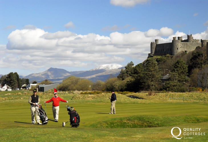 Harlech Castle overlooks the coastal plain on the southern side of Tremadog Bay with the mountains of Snowdonia on the horizon, and the Royal St. Davids Golf Course below, between the well-known walls of Harlech Castle and the sea