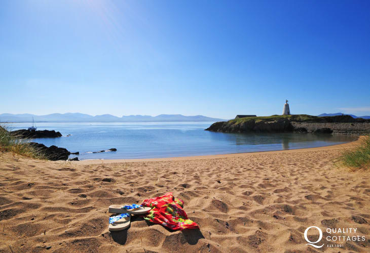 Take a day trip to Anglesey from Nefyn. Here you can see the mountains of the Lleyn Peninsula from Llanddwyn Island