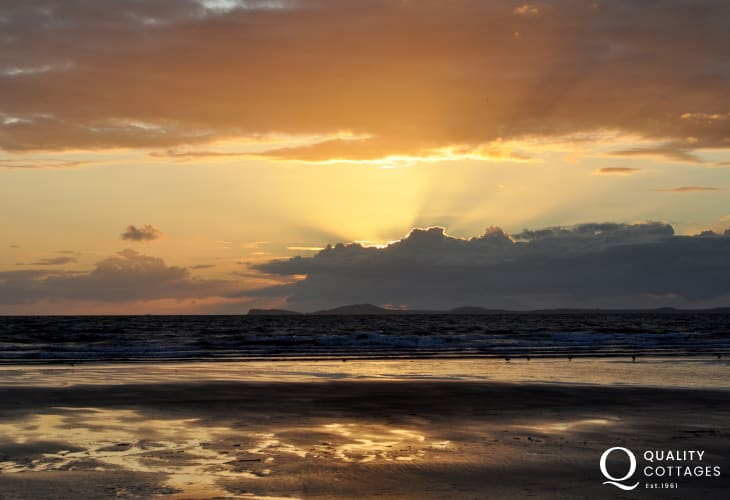 On a summers evening head to the coast and watch the sun set over the bay