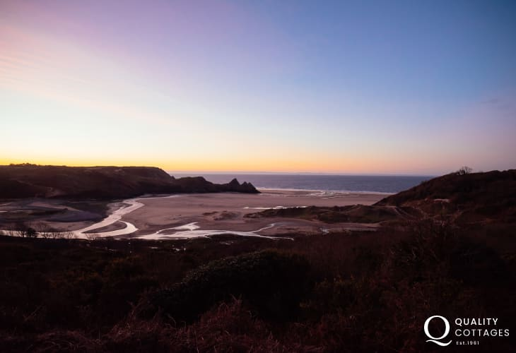 Sunrise over stunning Three Cliffs Bay on the Gower Peninsula