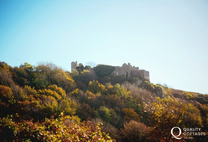 Penmaen Castle stands guard over Three Cliffs Bay, Tor Bay and Pobbles Beach