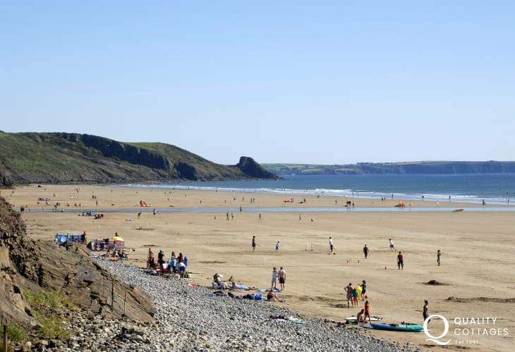Newgale Beach (Blue Flag) is a stunning 2 mile stretch of golden sand popular for surfing, kayaking kite surfing
