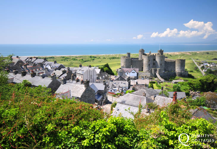 Harlech Castle perched on a rocky outcrop overlooks Harlech's long sandy beach
