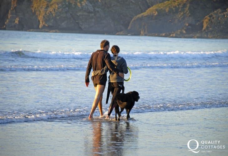 Enjoying the beach - most Quality Cottages welcome pets