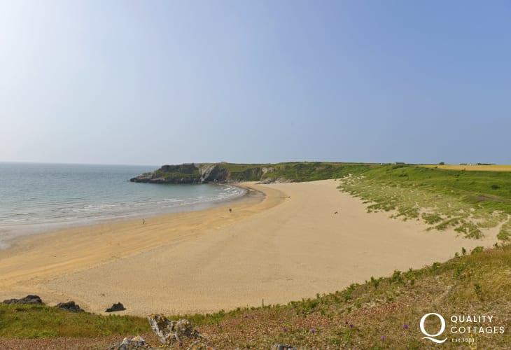 Broad Haven South a wide sandy bay backed by dunes that lead from The National Trust owned Bosherston lily ponds