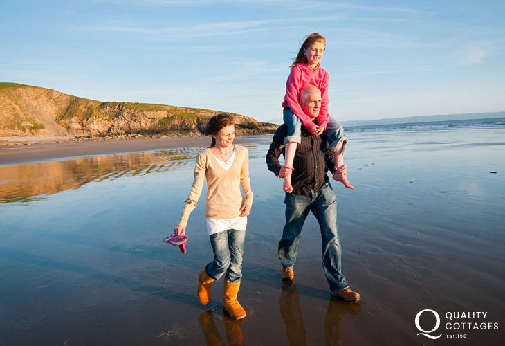 Taking time out together on the sands of Dunraven Bay.
