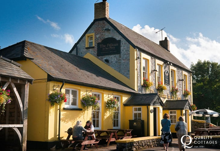 The Pelican Inn - overlooking Ogmore Castle this traditional country pub offers real ales, good food and is only a short drive away.