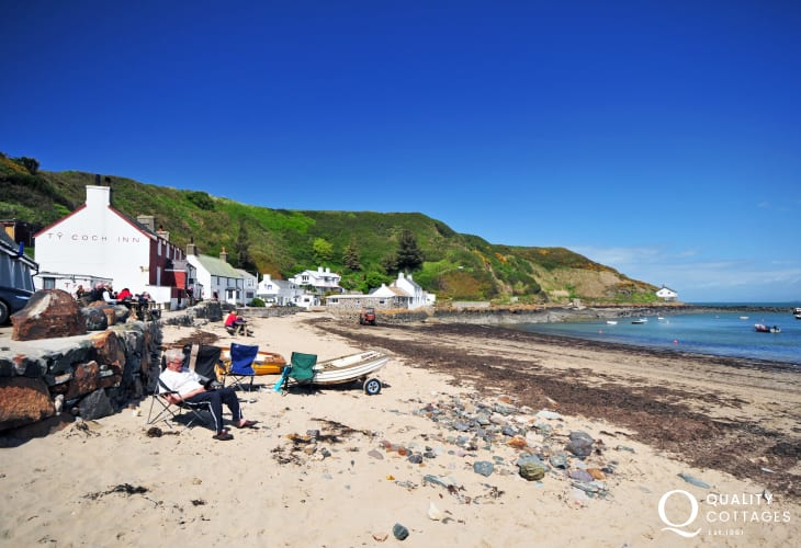 Porthdinllaen, enjoy lunch on the terrace at the Ty Coch Inn