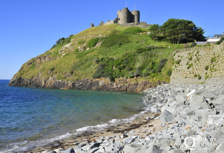 Criccieth Castle on the grassy headland with amazing views out to sea