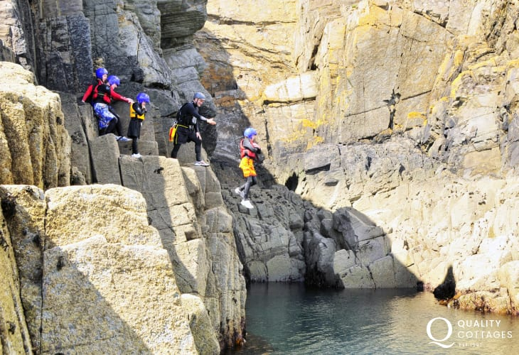 Coasteering trips available along the North Pembrokeshire coast around St. Davids. A cliff jumping adventure that is bound to be a memorable holiday experience!