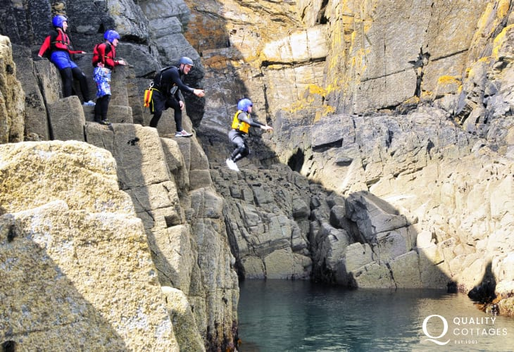 Coasteering off the rocks in the Blue Lagoon at nearby Abereiddy