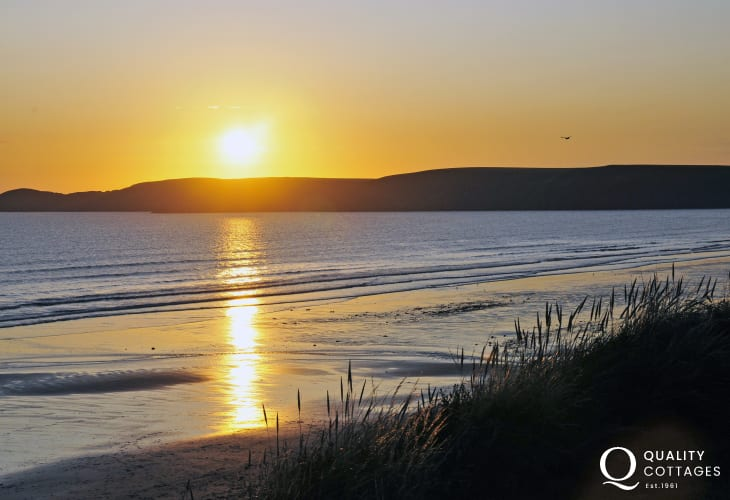 Newgale Beach as the sun goes down over St Brides Bay