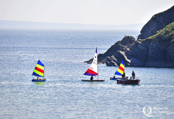 Solva Sailboats offer dinghy tuition, dinghy hire, powerboat courses or just enjoy sailing in St Brides Bay
