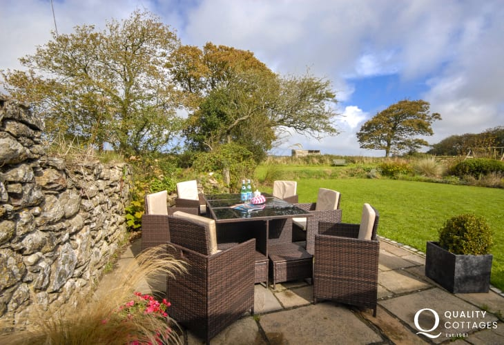 Pet friendly St Davids holiday cottage - gardens with rattan furniture