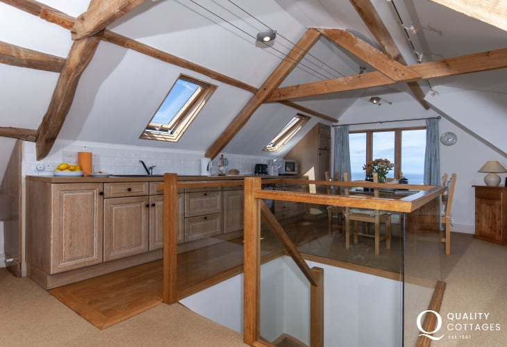 Self catering Strumble Head farmhouse with sea views - kitchen/dining area