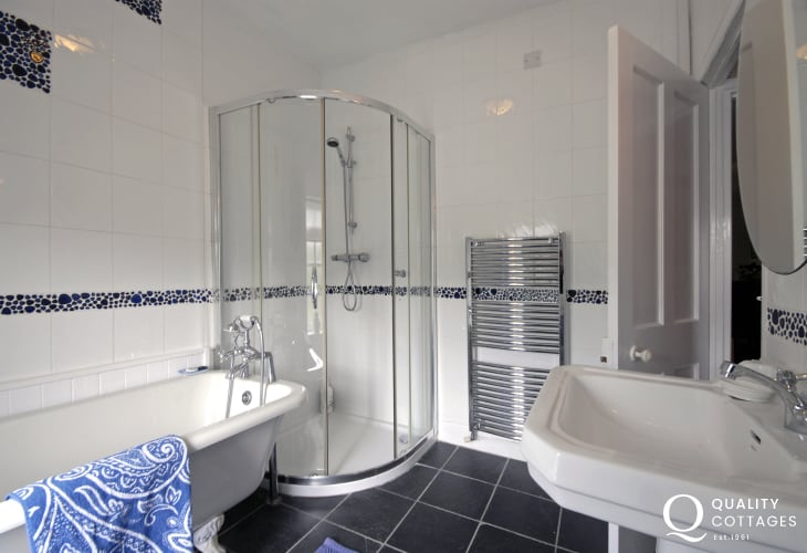 Bathroom with roll top bath and separate shower